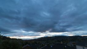Time lapse of clouds over residential homes in Happy Valley Oregon at sunset 4k. Ultra high definition 4k time lapse movie of moving clouds over residential real stock video
