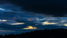 Time lapse of clouds over residential homes and landscape of Happy Valley Oregon from sunset into blue hour 4k stock video