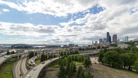Time lapse of clouds over Seattle WA city skyline and interstate freeway auto traffic 4k uhd stock video