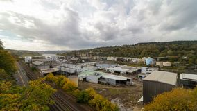 Time lapse of clouds over Willamette Falls Paper Mill in Oregon City one fall day in autumn season 4k uhd stock footage