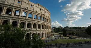Time-Lapse of clouds and people near historic structure in Italy, Rome, Coliseum stock video footage