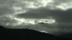 Time lapse of clouds rolling by hillside stock video footage