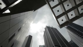 Time Lapse of clouds rolling by at office buildings in financial district Stock Image