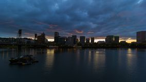 Time lapse of clouds and sky over downtown Portland Oregon at sunset 4k uhd. Time lapse movie of moving clouds and sky over downtown city skyline of Portland stock footage