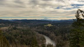 Time lapse of clouds and sky over the Sandy River and snow covered Mt. Hood in Oregon 4k uhd stock footage