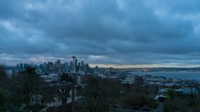 Time lapse of clouds and sky over Seattle WA at sunrise one early morning stock video footage