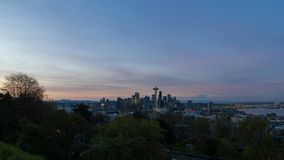 Time lapse of clouds and sunrise over Seattle WA with Mt. Rainier 4k uhd. Ultra high definition 4k time lapse movie of clouds and lights over expansive urban stock video