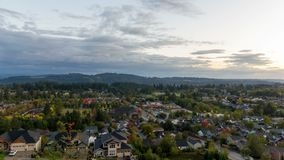 Time lapse of clouds and sunset over homes in Happy Valley Or early Fall Season. UHD 4k time lapse of clouds and sunset over suburban residential homes in Happy stock footage