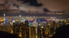 Time lapse of clouds and traffic over Hong Kong and Victoria Peak Harbor at night stock video