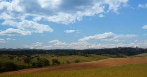 Time-lapse of cloudy sky over fields with beautiful scenic nature in the village in Italy, Tuscany.. 4K stock video