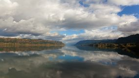 Time Lapse of Clouds and with Water Reflection along Columbia River Gorge 4k stock footage