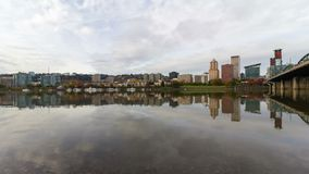 Time lapse of clouds with water reflection over city skyline of Portland OR 4k stock footage