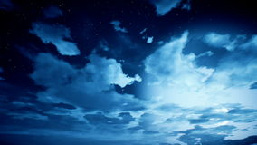 Time lapse of cloudscape with stars and moon stock video footage