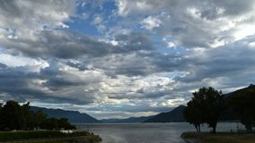 Time Lapse of cloudy blue sky at sunset above of Lake Maggiore. stock video