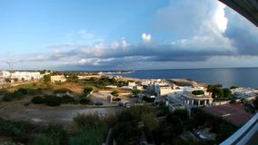 Time lapse of cloudy sky at dawn in Polignano a Mare