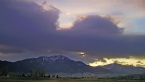 Time lapse colorful clouds over snowy mountains. Video of time lapse colorful clouds over snowy mountains stock video