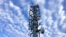 Time-lapse. Communications tower. With antennas against blue sky stock footage