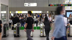 Time Lapse of  Commuters using Turn Style at Busy Tokyo Metro Rail Station stock footage