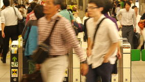 Time Lapse of Commuters using Turn Style at Busy Tokyo Metro Rail System stock video