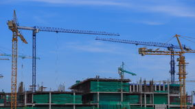 Time-lapse of construction cranes with cloud and sky stock video footage