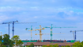 Time-lapse of construction cranes with cloud and sky stock video