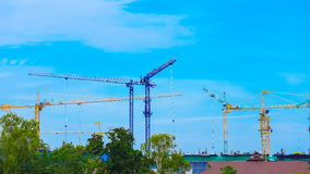Time-lapse of construction cranes with cloud and sky stock footage