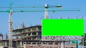 Time lapse construction site and green big billboard