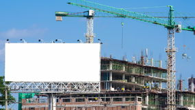 Time lapse construction site and white big billboard stock video footage
