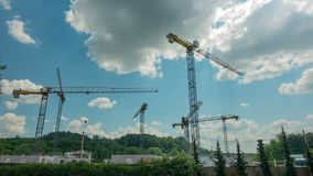 Time-lapse of construction site works with crane. 4K UHD wide angle shot. VILNIUS, LITHUANIA - JUNE 2, 2016: Time-lapse of construction site works with crane. 4K stock video