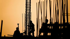 Time lapse - construction worker silhouette stock video footage