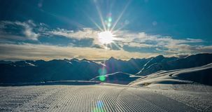 Time-lapse of corduroy snow in the foreground and mountains 4K stock footage