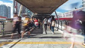 Time-lapse of crowded Asian people walk on public pedestrian walkway. Commuter lifestyle, Asia city life, transportation concept