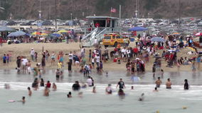 Time Lapse of Crowded Beach in Santa Monica California stock video footage