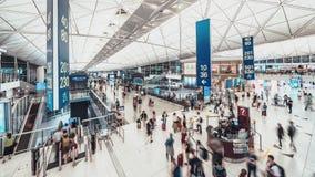 Time-lapse of crowded people walking in Hong Kong airport transit terminal. Air transportation, international tourism