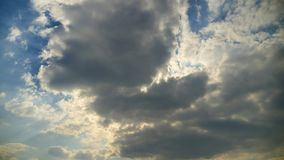 Time lapse of cumulus clouds against a blue sky. White clouds tighten the sky. stock video