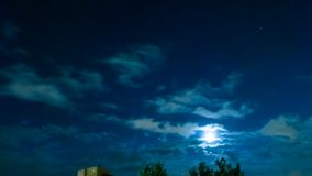 Timelapse of night sky and moon. TIME LAPSE: dark sky with moving clouds, the full moon shining and moving clouds at night, timelapse with copy space. Holiday stock video