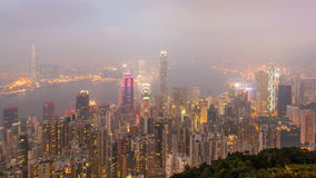 Time Lapse Day To Night Hong Kong City and Mist in Sky From High Viewpoint Of The Peak stock video footage