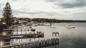 Time Lapse from day to night of lake, piers, boats and clouds stock footage