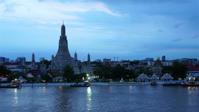 Time-lapse Day to Night Top view Was Arun and traffic on Chao Phraya river Bangkok,Thailand ;pan effect. Clip of Time-lapse Day to Night Top view Was Arun and stock footage