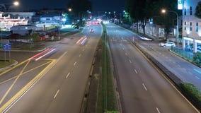 Time Lapse del tráfico en el enfoque de la noche hacia fuera, 4k almacen de video