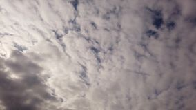 Cirrocumuli clouds in time lapse -  banks of white clouds blowing with shadows and crosses each others with wonderful wrapping sky. Time lapse of dense and stock video footage