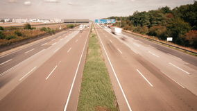 Time lapse of dense traffic on German highway. A5 nearby Frankfurt Airport - high-angle view from a bridge stock footage