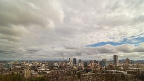 Time lapse of dramatic moving clouds and highway traffic with downtown cityscape of Portland OR and Fremont Bridge 4k stock video