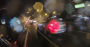 The car in the night city traffic in the rain stock video footage