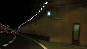 Time lapse of driving though a tunnel at night. Munich, Germany stock video