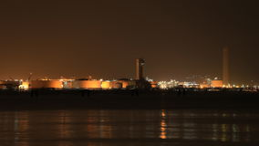 Time-lapse of electrical power plant near the sea coat at night, Rayong, Thailand stock video