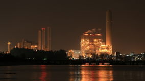 Time-lapse of electrical power plant near the sea coat at night, Rayong, Thailand stock footage