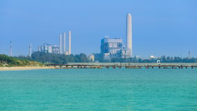 Time-lapse of electrical power plant near the sea coat, Rayong, Thailand stock footage