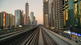 Time lapse of elevated metro train travelling along Sheikh Zayed road. Dubai stock video footage
