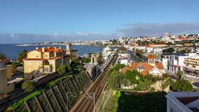 Time-lapse in Estoril with trains, clouds and traffic. Aerial view Time-lapse in Estoril with trains, clouds and traffic stock footage
